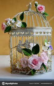 bird cage with spring blossom flowers wedding decorations