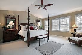 The Ceiling Of This Master Bedroom Is Arched At The Center And Slopes To  Flat Above