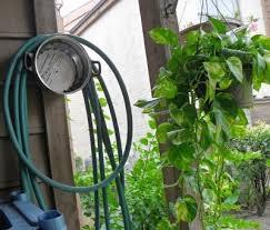 homemade garden hose hanger ideas