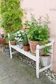 garden bench with flower pots