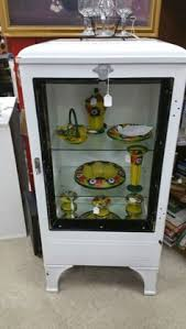 refrigerator end table. old refrigerator turned into shelving end table d