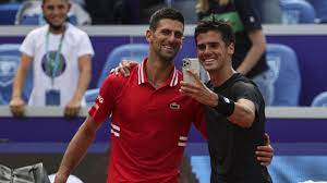 Federico Coria is happy about a selfie with the world number one after  clapping against Novak Djokovic