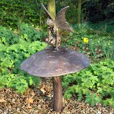 fairy on a mushroom with aged bronze finish