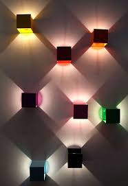 wall lighting effects. The Modular Design Is Made Up Of Colored Aluminium Cubes Which When Lit, Project An Outward Triangular Light. Units Can Each Make Full 360 Degree Wall Lighting Effects