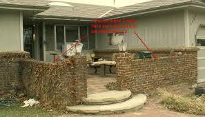 free standing brick wall settling courtyardwall jpg