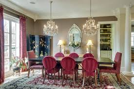 formal dining room has hardwood floors pillars double chandeliers and a one of a kind wet bar butlers pantry