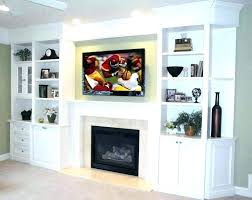 above fireplace cabinet behind screen electric for tv over lift firep