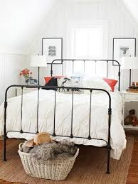 old iron beds. Fine Iron Attic Bedroom  Black Paint Updates An Old Iron Bed White Painted Bead  Board Framed Art On Either Side And Old Iron Beds A