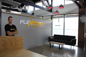 managing director tony y inside the industrial styled entrance of flex fitness morrinsville photo