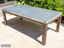this outdoor dining table was built to withstand the elements it features a galvanized sheetmetal top treated with an acid wash giving patina similar metal dining table e77 metal