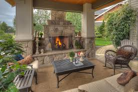outdoor covered patio with fireplace ideas at modern home
