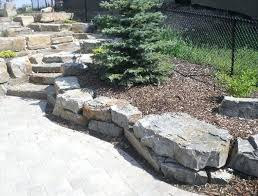 rock retaining wall cost stack rust retaining wall blocks natural rustic steps installed average cost to build stone retaining wall