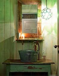 love this galvanized bucket repurposed into a bathroom sink very kitschy and look at the faucet