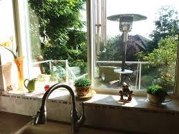 Decorating Kitchen Windows Kitchen Window Sill Decorating Ideas Miserv