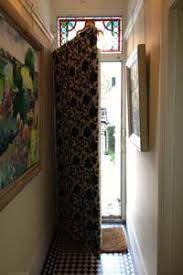 front door curtains. JPG · Brass Rising Portiere Fitted To A Front Door In Central London With Interlined Curtain - Half Open. Curtains T