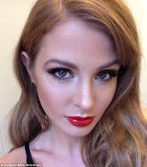 glam millie mackintosh shared a picture of herself fully made up during a fashion