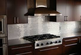 kitchen backsplash ideas with dark cabinets stainless steel moen kitchen faucet two white pendant lamp white