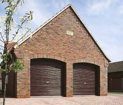 picture of steel line roller garage doors in mahogany wood laminate finish