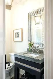 black sink vanity with art deco mirror contemporary bathroom powder room mirror