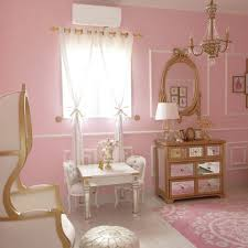 bedroom white flower pink cushions pink clothed pillows pink tasseled blanket red sheer curtain parquet flooring
