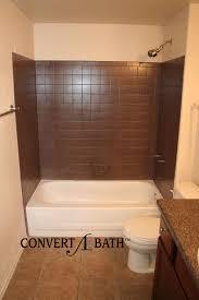 refinishing repair bathtub surrounds with dark wtile wall for bathroom design
