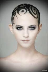 спирали в тату на женской голове Tatufotocom