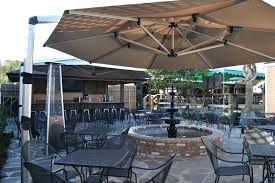 find refuge from the sun with patio umbrellas from cool off