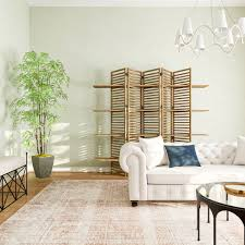 The high upholstered back on this bench is great for a tall wall space. Living Room Decor Ideas 17 Ways To Decorate Blank Living Room Walls
