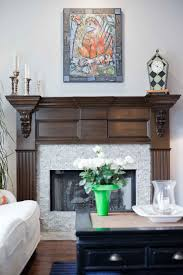 fireplace mantel refinished to a custom wood grained faux stain finish with black glaze