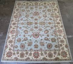 rk14 0106 hand knotted oriental carpet indo persian featuring a fl decorated light blue field and cream border 8 11 x 12 1