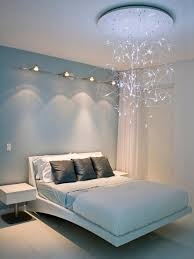 chandelier track lighting. inspiration for a contemporary bedroom remodel in miami with blue walls chandelier track lighting t