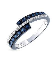 <b>Кольцо</b> с 16 бриллиантами, 0.04 карат; <b>1 топаз</b>, 0.57 карат ...