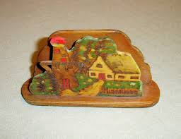 very old wooden napkin holder shaped lighthouse and house marked middelburg