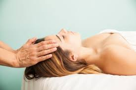Image result for photo of person undergoing reiki treatment