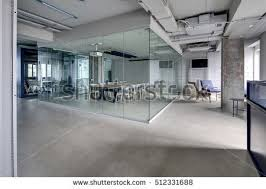 loft style office. meeting zone in the office a loft style with white brick walls and concrete columns