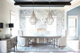 white beaded chandelier dining room double beaded chandelier skirted parsons chair chair rug cloud wallpaper black