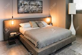 Double Bed Led Light View Of Double Bed With Grey Linens In Cozy Interior With Warm