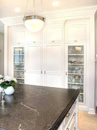 an example of a black honed granite in a kitchen with white cabinets