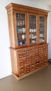 rare pine grocery display cabinet with 3 glass doors and 60 drawers 19th