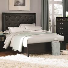 black wooden bed frame with tufted leather headboard and white bedding set