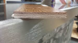 the engineered approach is real hardwood flooring over a plywood base keeping it structurally sound to resist against moisture problems associated with