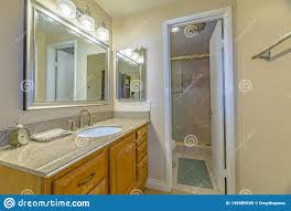 Extended Bathroom Vanity Light Vanity Unit With Brown Wooden Cabinets And Bright Lights