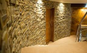 dimensional interior stone veneer radius wall with a door in a residential stairwell