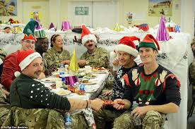 Troops tuck into Christmas dinner while serving in Afghanistan ...