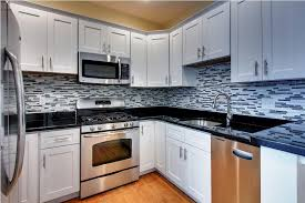 kitchen cabinets with granite countertops: image of black granite countertops with white kitchen cabinets