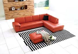 cool sectional sofas a traditional l shaped sectional in a bright bold pumpkin colored leather sectional