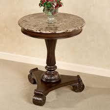 round cream marble counter top plus pedestal stand also three brown wooden legs with carving ornaments appealing round wood accent table