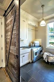 laundry room barn door laundry room rustic laundry room featuring a sliding barn door gray tile