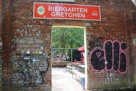 located in linden near faust and mephisto is gretchen beer garden situated behind a graffiti wall is a two level garden packed with art color and funky