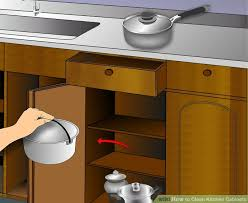 image titled clean kitchen cabinets step 1